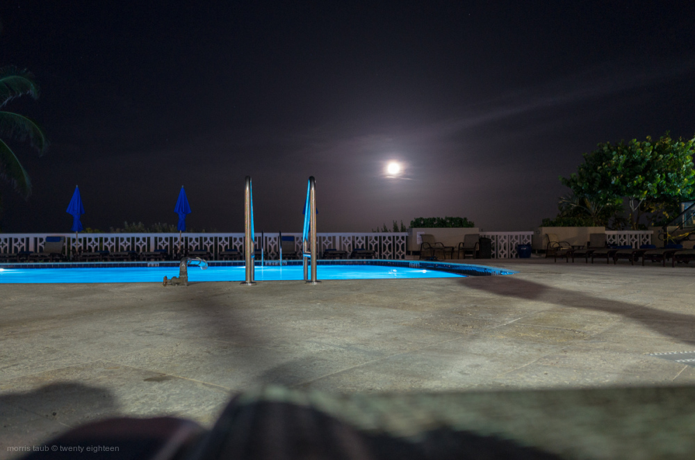 Miami Beach pool at night. Summer dad died.