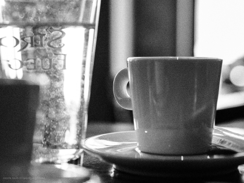 Water glass, coffee mug at cafe in France.
