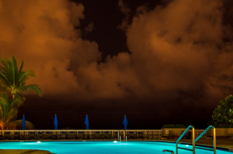 Pool and clouds at night. Miami Beach, Florida.