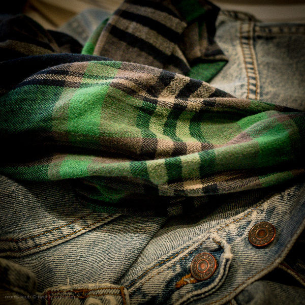 Worn dungaree jacket and scarf.