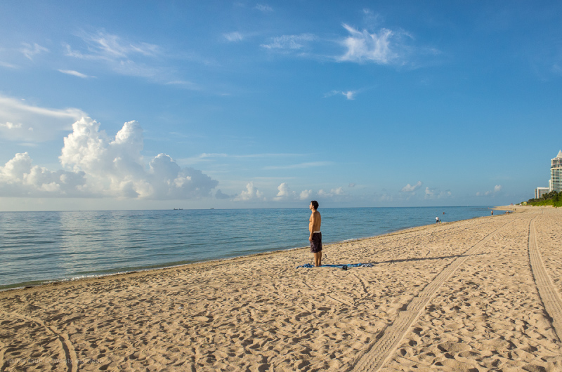 Man watching sunrise miami beach florida.
