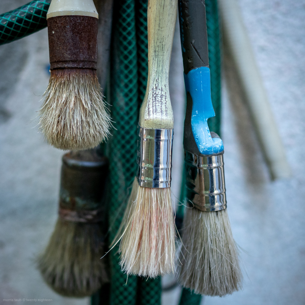 Hanging paint brushes.