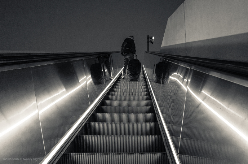 Man headed into the train station at night.