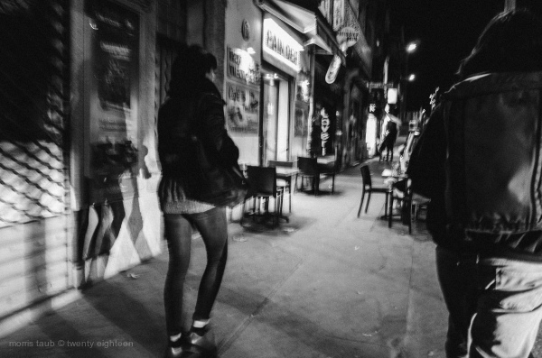 Girl and boy walking at night.