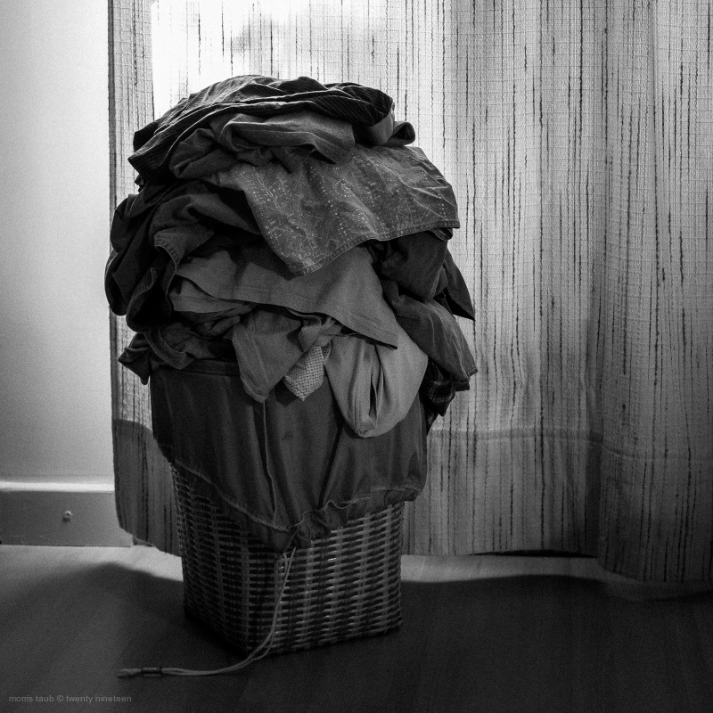 Overflowing laundry basket.
