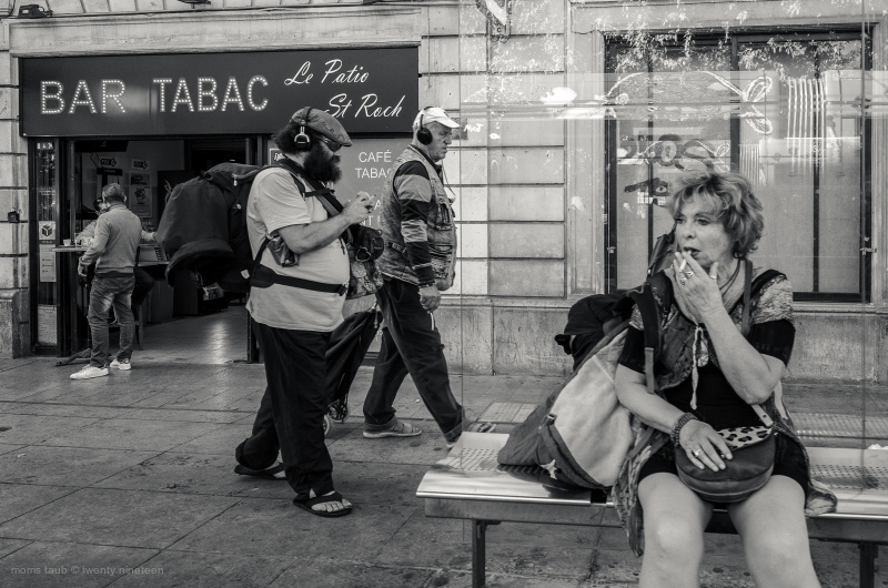 Woman waiting for a tram.