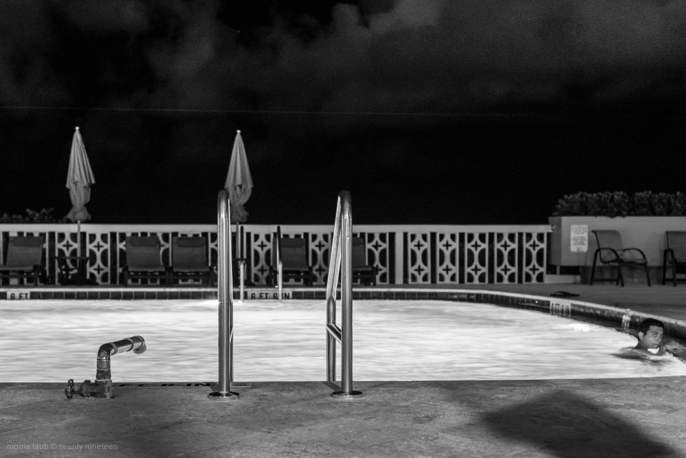 Swimming pool at night, Miami Beach, Florida.