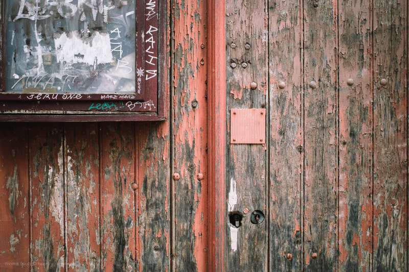 Old wood door with chipping paint.