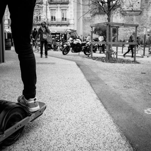 Motorized skate board in town.