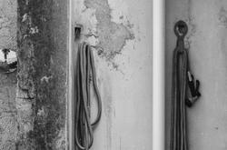 Garden hoses hanging.