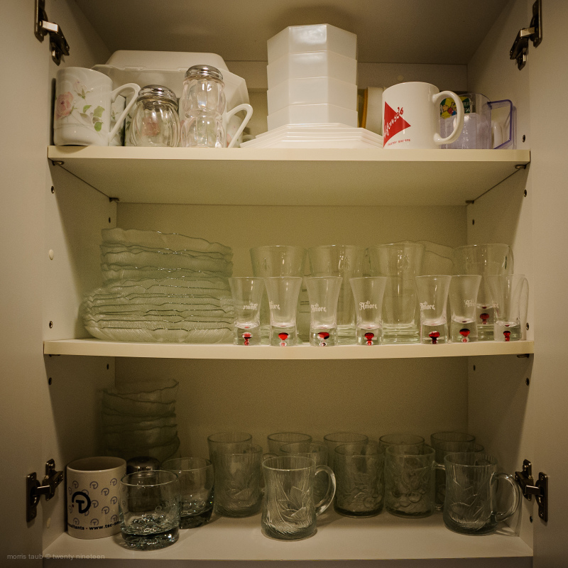 Inside cupboard in dads kitchen. Miami Beach, FLA.