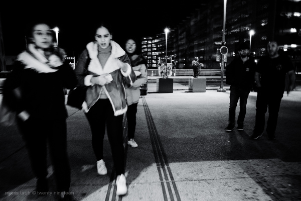 Heading into train station at night.