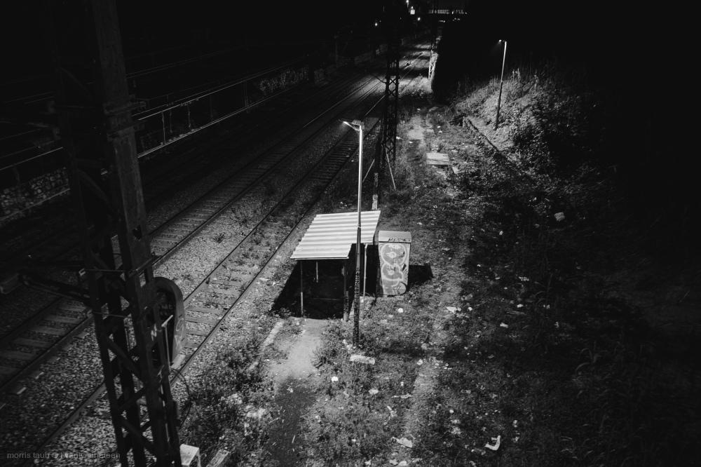 Train tracks at night.