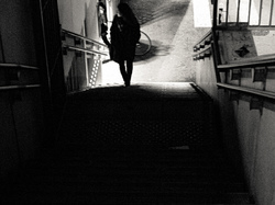Girl on the stairs behind the train station.