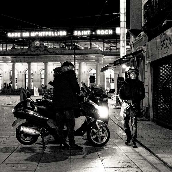 Two men about to leave on motorcycles.
