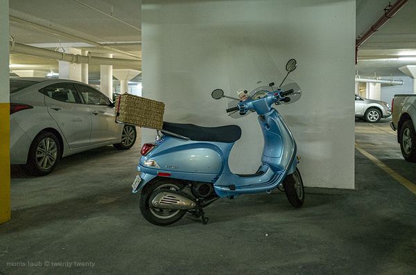 Blue Vespa in garage where my parents lived.