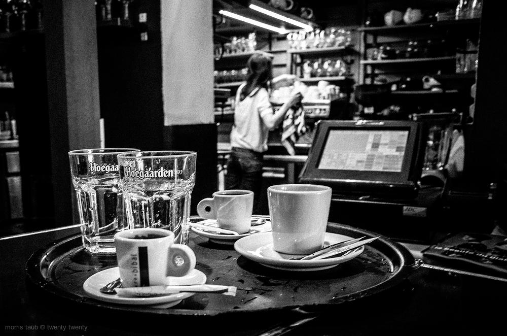 Preparing coffee for customers.
