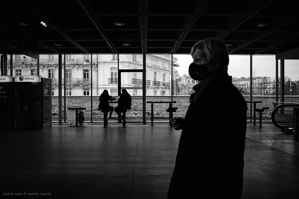 3 Women waiting at the train station.