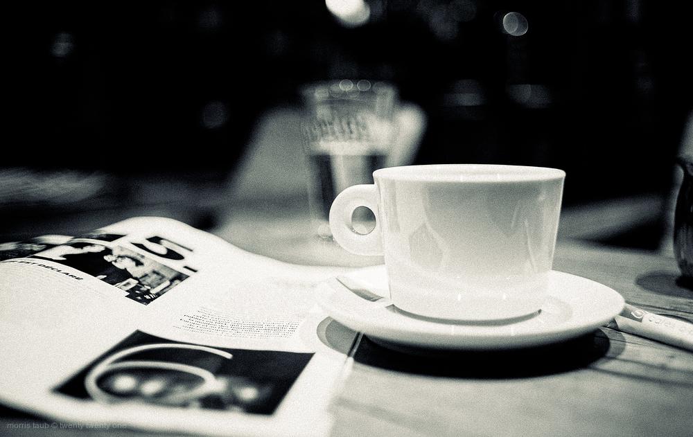 Leisure at cafe latitude. Coffee, water, magazine.