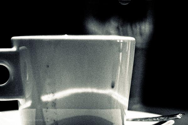 Cafe close up of mug and spoon.