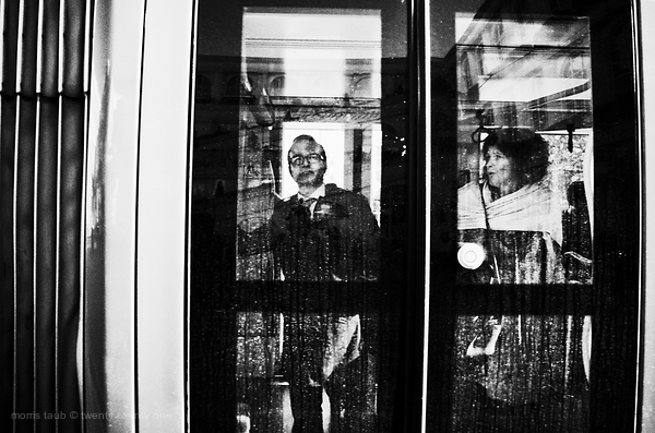Man and woman commuting by tramway.