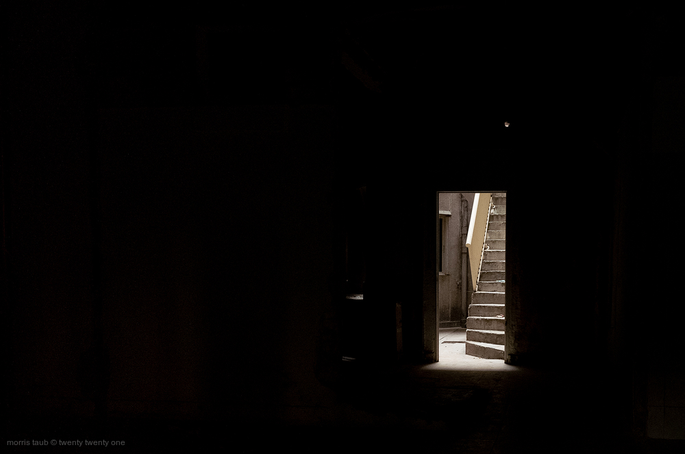 Steps through a doorway.