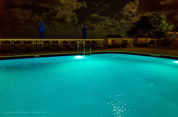 Poolside miami beach at night.