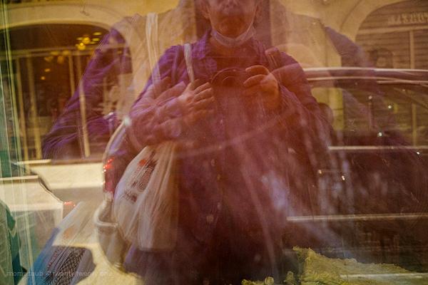 Self-portrait in store window.