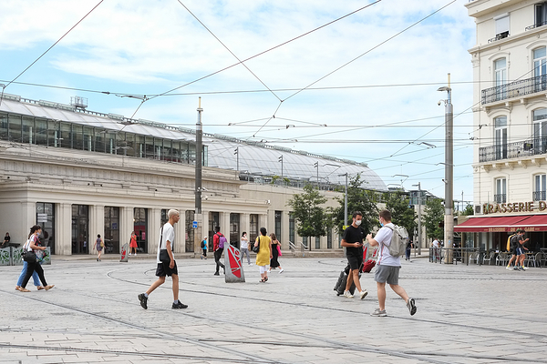 Intersection of people and tramway lines.
