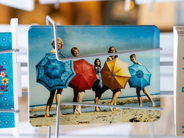 5 women with umbrellas on the beach. Nostalgic.