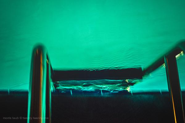 Pool ladder at night, miami beach, florida USA