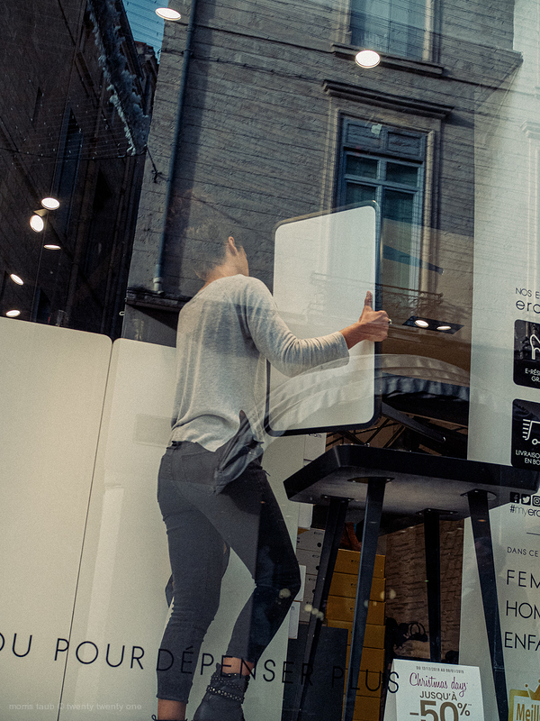 Setting up store window in Montpellier.