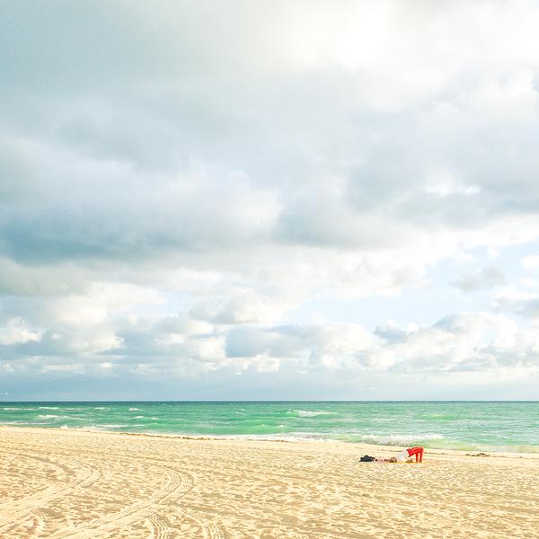 Man practicing yoga on Miami Beach Florida.