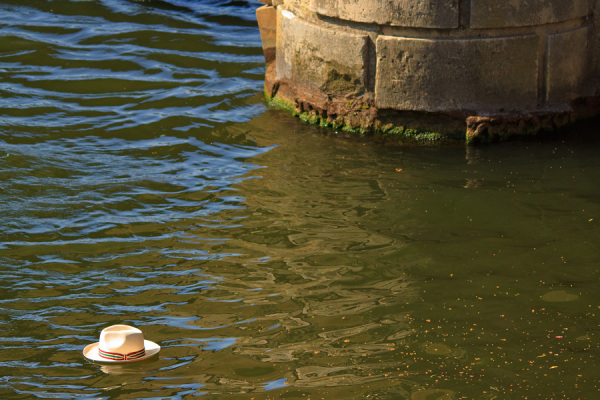 Hat on the river Thames at Henley Bridge.