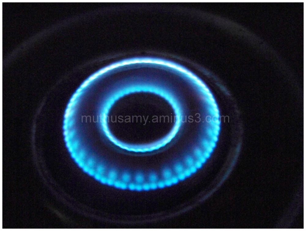 Blue flame of LPG gas stove Closeup of in the dark