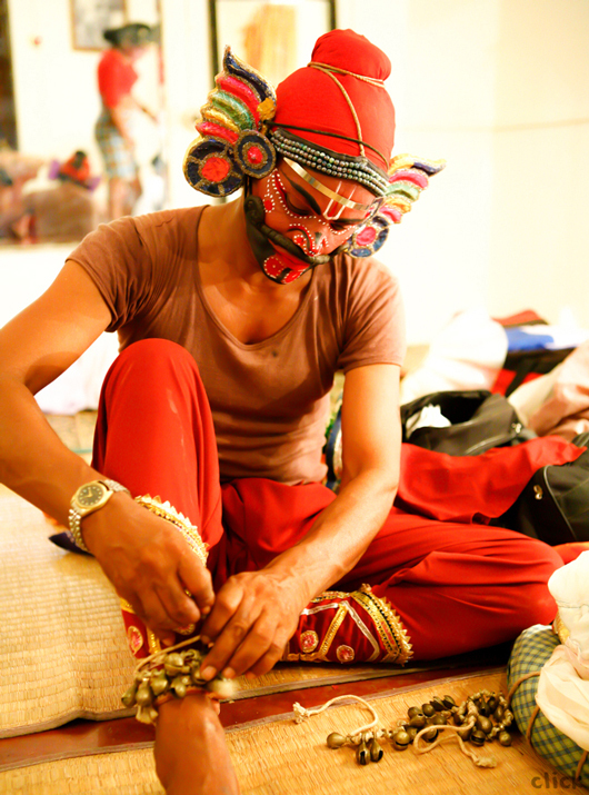 A folk artiste getting ready to perform