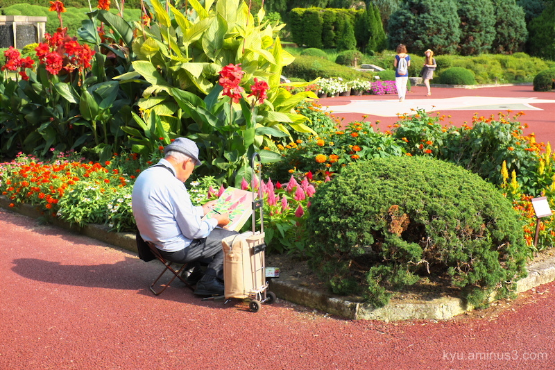 An artist in a garden