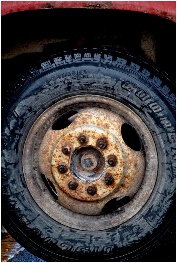 Rusty hubcap on small truck wheel