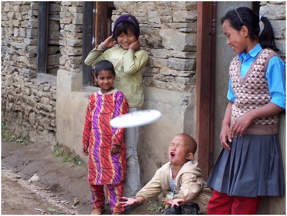 Boy catching frisbee at a school in Helembu, Nepal