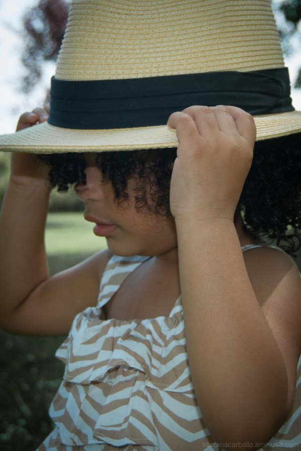 Naly playing with a hat