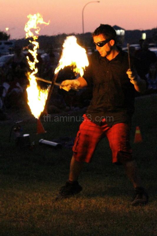 Man juggling fire