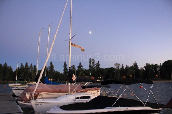 Boats tied up at night