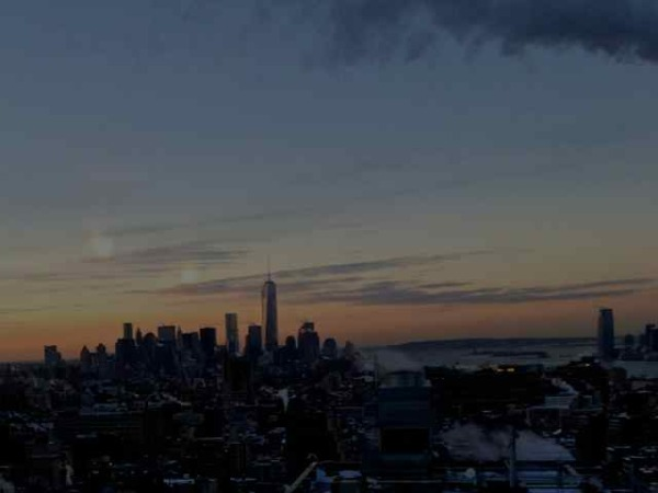 New WTC and view of NYC downtown at sunset