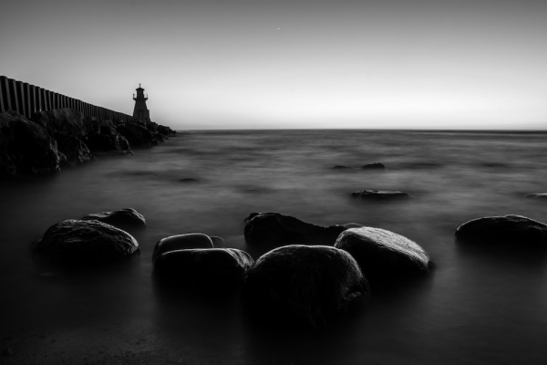 A black and white long exposure by the lighthouse