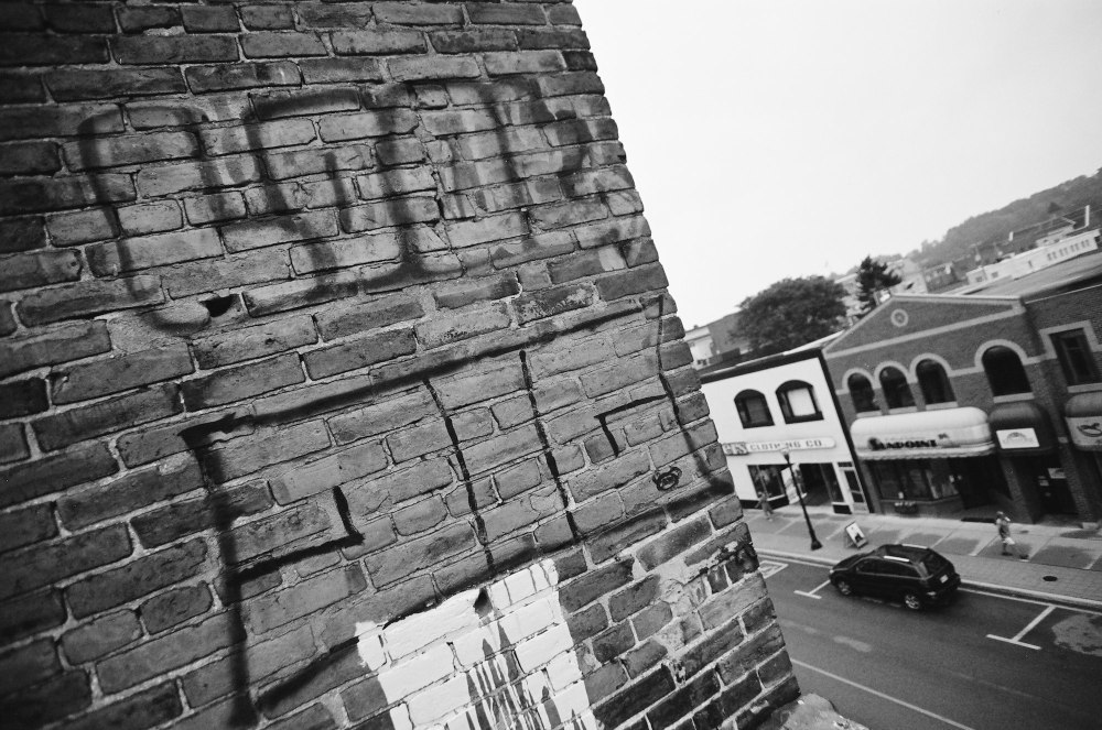 Wide angle graffiti on top of a building