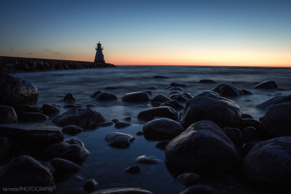 A long exposure on a beach with a lighthouse