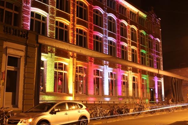 Colourfull illumination of the facade of STUK Leuv