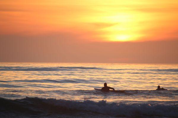 Surfing in the sunset, Sunset Cliffs, San Diego