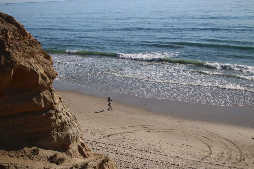 Lone Jogger on Torrey Pines Beach, San Diego