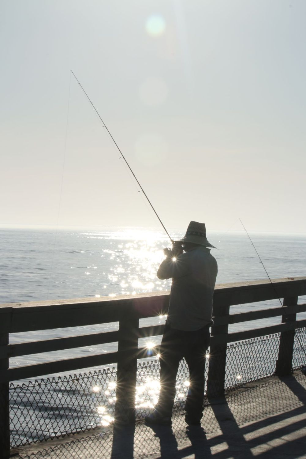Fisher on Ocean Beach pier, San Diego